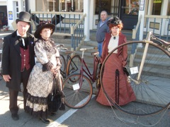photo of visitors in periodic costumes by Wheelmen bicycles at 2010 McKinley Day festival