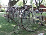 photo of a few Ordinary bicycles tied up